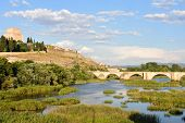 view of bridge and the Castle of Henry II of Castile (14th century) and River Agueda, Ciudad Rodrigo, Castile and Leon, Spain poster