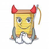 Devil thread bobbin isolated on a mascot poster