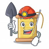 Miner thread bobbin isolated on a mascot poster
