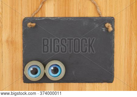 Privacy Concerns Blank Hanging Chalkboard Sign With Eyes On Wood With Copy Space For Your Privacy Ke