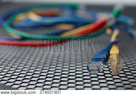 Network Ethernet Cables. Network Switch With Optical And Ethernet Connected Wires.
