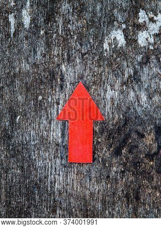 Red Arrow On The Old Wooden Background Closeup