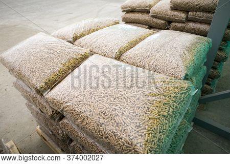 Wooden Pellets In Plastic Bag. Pellets- Biomass.