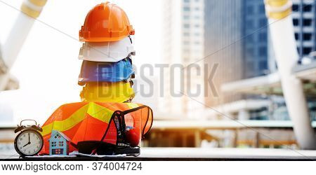 Safety Construction Worker Hard Hat. Teamwork Of The Construction Team Must Have Quality. Whether It