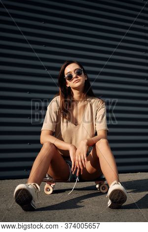 Young Woman With Longboard. Girl Skater Posing On Longboard In Sunny Weather.