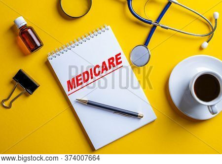 Medicare Is Written On A Yellow Background In A White Notebook Near Medical Accessories