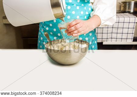 Cooking Dough For Baking In Home Kitchen. Female Hands Pour Boiling Water Into A Glass. Homemade Foo