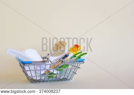 Shopping Basket With Baby Care Items - Scissors, Two Hairbrushes, Thermometer, Cotton Pads And Nasal