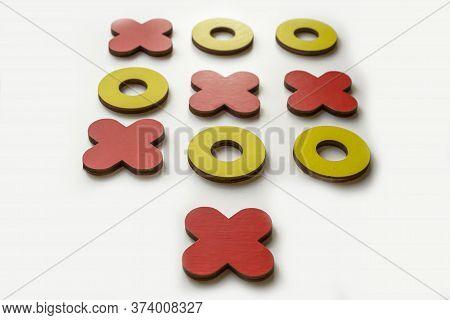 Kid Tic-tac-toe Wood Board Game On White Background. Developmental Game For Children. Family And Fri