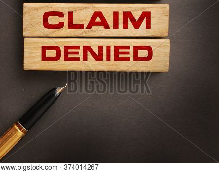 Claim Denied Words On Wooden Blocks And Luxury Pen. Reject Business Financing Concept