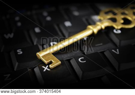 A Shiny Brass Key Rests On Top Of A Computer Keypad For Conceptualizing Security Issues In The Moder