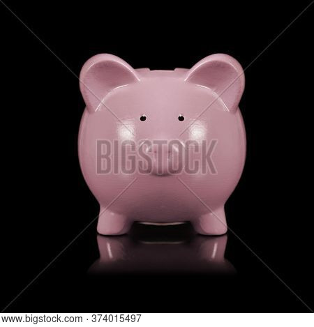 An Isolated Over A Black Background Image Of A Pink Piggy Bank For Saving Coins.