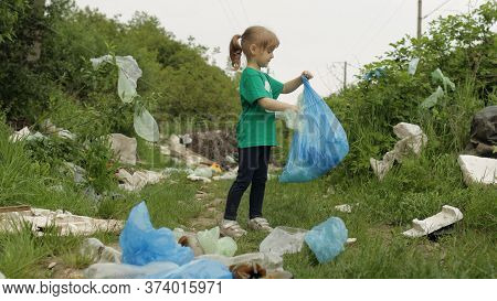 Volunteer Child Girl Kid In Green T-shirt Tidying Up Rubbish In Park, Cleaning Up Dirty Forest From