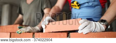 Close-up Of Builder Laying Brick With Professional. Workmen At Work, Bricklayers Building Wall, Cont
