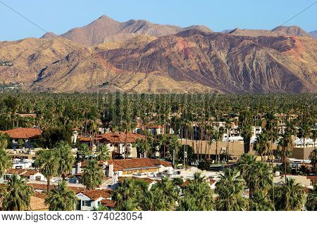 June 22, 2020 In Palm Springs, Ca:  Urban Desert Landscaping Including Palm Trees Surrounding Downto