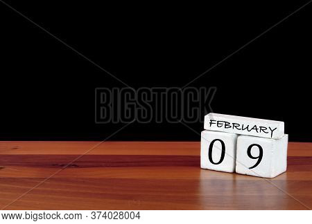 9 February Calendar Month. 9 Days Of The Month. Reflected Calendar On Wooden Floor With Black Backgr