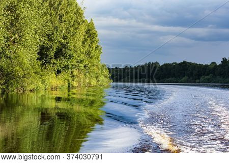 Walk On A Boat Along The Riverbank. Nature On The Banks Of The Volkhov River.