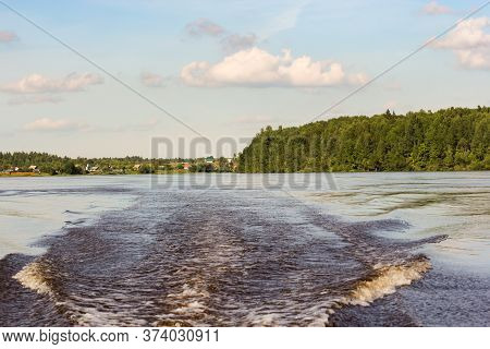 Trail From An Outboard Motor On The Water. Nature On The Banks Of The Volkhov River.