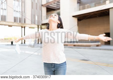 Smiling Mid Adult Woman Enjoying Freedom After Coronavirus Isolation Period