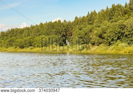 Nautical Signs On The Shore In The Forest. Nature On The Banks Of The Volkhov River.
