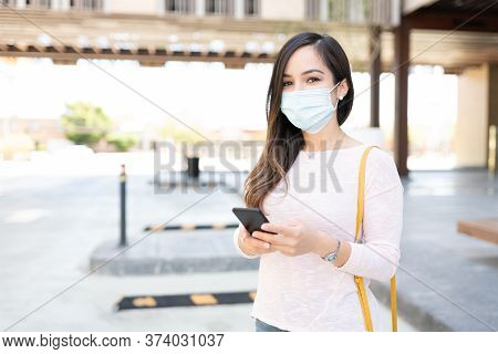 Mid Adult Woman Wearing Face Mask During Coronavirus Crisis In City