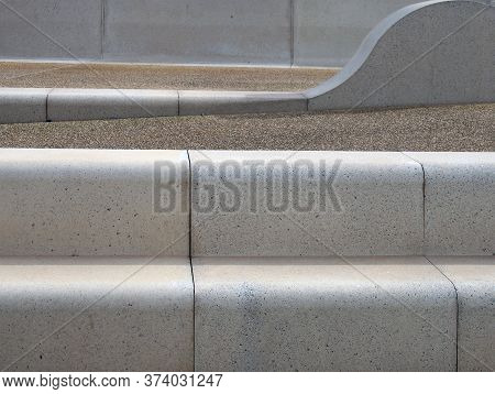 Modern Angled Outdoor Steps With Rounded Corners Int Textured Grey And Brown Colors
