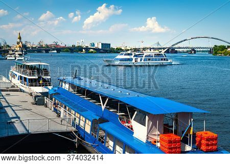 Passenger Cruise Ship Enters The Port. Navigation On The Dnieper. Weekend Walks.