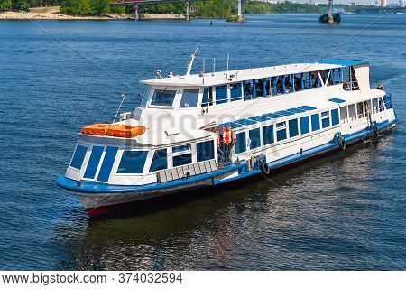 Pleasure Boat Floats On The River. Navigation On The Dnieper. Weekend Walks.