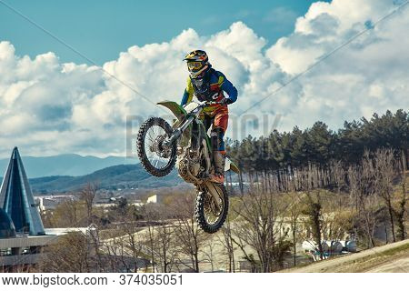 Extreme Concept, Challenge Yourself. Extreme Jump On A Motorcycle On A Background Of Blue Sky With C