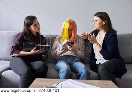 Family Mother And Teenage Daughter In Meeting With Psychologist. Professional Help, Support, Women A