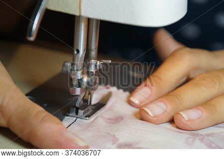 Homemade Protective Face Masks. Sewing Machine And Female Hands.