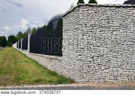 Fence. Impressive And Very Durable Fence Of The Property Made Of Split Granite.