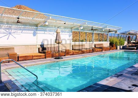 June 22, 2020 In Palm Springs, Ca:  Contemporary Style Patio Furniture Surrounding A Rooftop Pool Ta