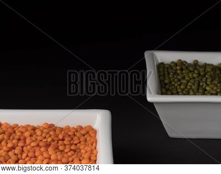 Lentils And Mung Beans In Square Bowl On Black Background.