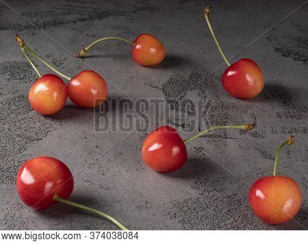 Pink Cherries On Gray Background. Organic Berries.