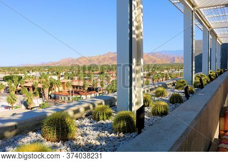 Rooftop Outdoor Patio Including A Drought Tolerant Garden On A Ledge With Manicured Barrel Cacti Pla