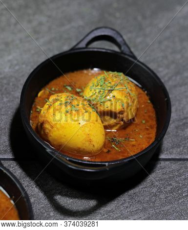 An Indian Spread Of Spicy Egg Curry Or Egg Masala In A Bowl