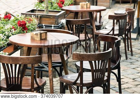 Empty Table Patio Cafe On The Street Wooden Furniture Without People Here Landscape Environment Spac