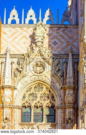 Magnificent decorated window of the Palazzo Ducale. Doge's Palace is a great monument of Italian Gothic architecture. Magical journey to Venice. The concept of photo tourism