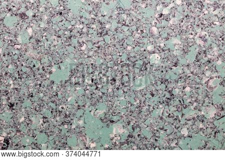 Grainy Light Green Plastic Surface. Top View. Close-up Shot. Abstract Idea.