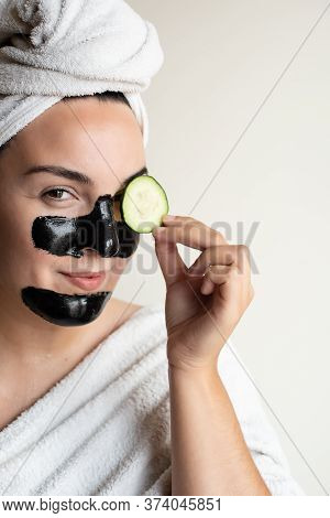 Woman Removing Blackheads And Dark Circles With Cucumber At Home