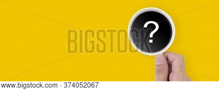 Hand Holding Cup Of Hot Coffee With Question Mark Isolated On Yellow Background, Top View, Q & A, Fa