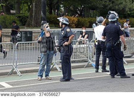 New York, New York/usa - June 2, 2020: Woman Speaks To Police Officer During George Floyd Protest  O