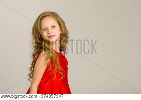 Charming Little Girl Princess In A Beautiful Dress. The Concept Of A Happy Childhood, Holidays. Clos