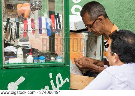 Cartagena, Colombia - January 24th, 2018: Portrait Of A Male Watchmaker Reparing A Watch At The Parq