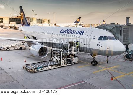Frankfurt, Germany - July 3th, 2018: Aircraft Truck Bags Loader At The Cargo Door Of A Lufthansa Air