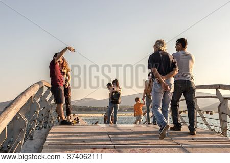 Volos, Thessaly, Greece - May 27th, 2018: People Walking And Taking Photos On A Little Bridge At The