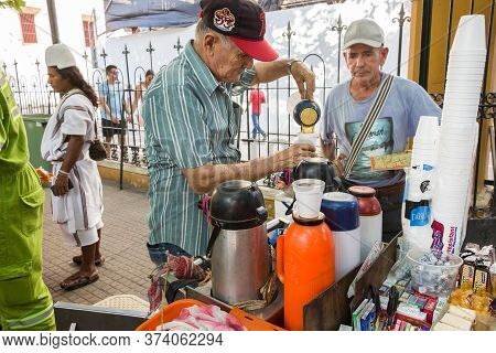 Cartagena, Colombia - January 23th, 2018: A Colombian Vendor Selling The Traditional Tinto, A Kind O