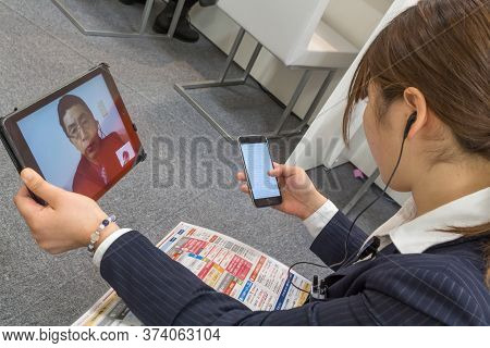 Nagasaki, Japan - March 26th, 2017: A Japanese Employee Is Talking With Her Boss By Skype In Order T