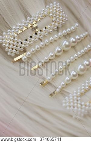 Pearl Hair Accessories. Hair Clips On Blond Hair . Fashionable Hair Accessories. Hairpin With Pearls